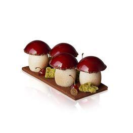 Bûche Sous-Bois, Laurent Duchêne - Les pieds sont réalisés grâce à une crème intense de chocolat noir de Tanzanie 75%, associée à une gelée de cerise griotte et une crème chantilly légère à la vanille, le tout caché dans une fine coque en chocolat. Les chapeaux sont une mousse au chocolat noir et des grains fins de streusel amande. Les champignons sont plantés sur une fine couche de biscuit à l'amande.